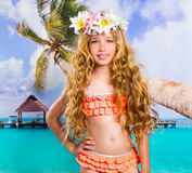Beach tropical vacation kid blond girl with fashion flowers. In head and palm tree Stock Images