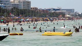 Beach in Tunisia. People bathing and sunbathing on the beach stock footage