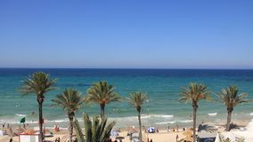 Beach in Tunisia. People bathing and sunbathing on the beach stock video footage