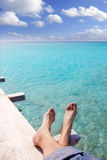 Beach turquoise tourist feet relaxed. On wood pier tropical sea Royalty Free Stock Photos