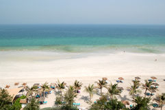 Beach and turquoise water of the luxury hotel Royalty Free Stock Image