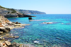 The beach and turquoise water on Mallorca. The beach and turquoise  water on Mallorca island, Spain Stock Photo