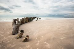 The beach in Tversted. Poles on a line into the sea on the beach in Denmark Stock Photography