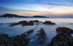 The beach in twilight, kalim beach phuket. Stone on the beach in twilight, kalim beach phuket Royalty Free Stock Photos