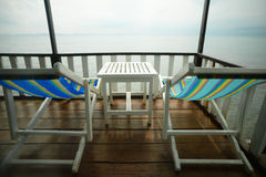 Beach, two deck chairs Stock Image