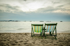 Beach, two deck chairs and blue sky Royalty Free Stock Photos