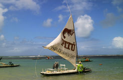 Beach with typical sail boats of northeast Brazil Royalty Free Stock Photography