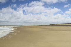 The beach in uk, cloudy sky. On the beach in uk, blue cloudy  sky Royalty Free Stock Photo