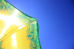 Beach umbrella. On a background sun sky Royalty Free Stock Images