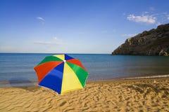 Beach umbrella. A colourful beach umbrella on an empty Tsambika (Tsampika) beach on Rhodes Island, Greece Royalty Free Stock Photography