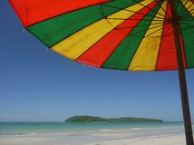Beach umbrella. View on tropical island from underneath a beach umbrella Royalty Free Stock Photo