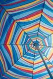 Beach Umbrella. Underneath a colourful beach umbrella Stock Images