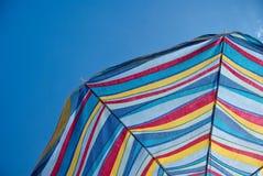 Beach Umbrella. Underneath a colourful beach umbrella with blue sky Royalty Free Stock Image