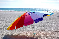 Beach Umbrella. Colorful beach umbrella in the sand Stock Photos