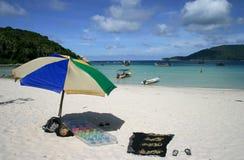 Beach umbrella. Multi-colored umrella on the beach stock photos