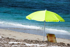 Beach umbrella. On a sunny day - sea in background Royalty Free Stock Photography
