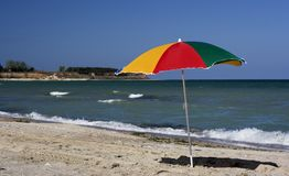 Beach umbrella. Color umbrella in the beach Stock Photography