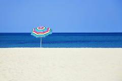 Beach umbrella. Seasonal and Holidays: sun umbrella on the beach Stock Photos