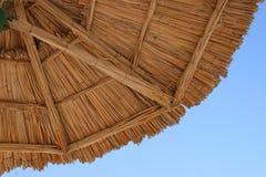 Beach Umbrella. Under a beach umbrella (vacation concept Royalty Free Stock Image