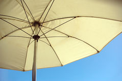 Beach umbrella. With a blue sky in the background Royalty Free Stock Image