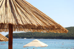 Beach umbrella in adriatic sea, Montenegro. Stock Photography