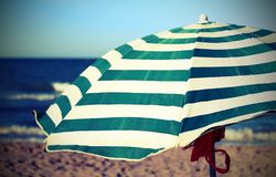 Beach with umbrella and an antique effect Royalty Free Stock Image
