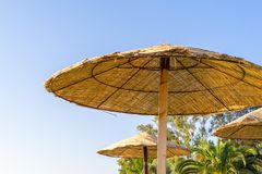 Beach umbrella or awning on a rack Royalty Free Stock Photo