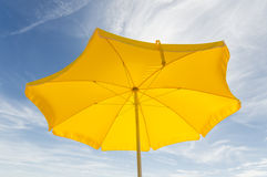 Beach umbrella. On the background of sky with clouds Stock Images