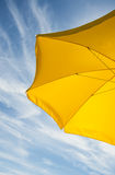 Beach umbrella. On the background of sky with clouds Royalty Free Stock Photos