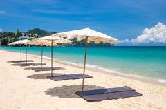 Beach umbrella on beach with blue sky Stock Photo