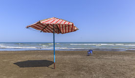 Beach umbrella and beach chair after the summer season on the co Stock Photo