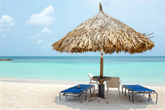 Beach umbrella and beach chairs on Palm Beach at Aruba island. In the Caribbean Sea Royalty Free Stock Image