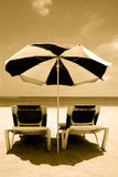 Beach Umbrella and Beds. Sepia beach view Stock Photography