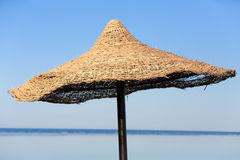 Beach umbrella and blue sky background Royalty Free Stock Image