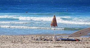 Beach umbrella and boards. Umbrella and boards on beach Gold Coast Australia Royalty Free Stock Image