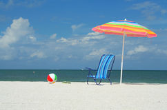 Beach umbrella, chair and ball royalty free stock images