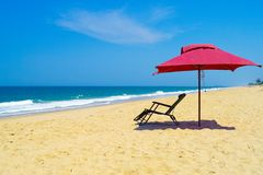 Beach umbrella and chair on beach. In Mozambique in Africa stock photography