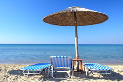Beach umbrella and chairs Stock Photo