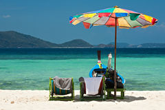 Beach umbrella chairs and boat in Coral island, Thailand. Beach umbrella chairs and boat in Komodo beach in Coral island, Thailand Stock Photography