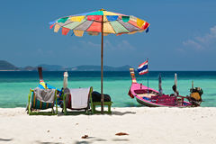Beach umbrella and chairs in Coral island, Thailand. Beach umbrella in Komodo beach in Coral island, Thailand Royalty Free Stock Photography