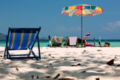 Beach umbrella and chairs in Komodo beach in Coral island, Thail Stock Photography