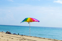 Beach umbrella colorful in the sand Stock Photography
