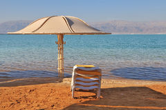 Beach umbrella and deck chair waiting for tourists Stock Photo