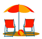 Beach umbrella and deck chairs Stock Image