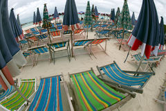 Beach umbrella and deck chairs on the beach. Royalty Free Stock Photography