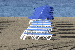 Beach umbrella with deckc Royalty Free Stock Photography