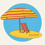 Beach umbrella and deckchair on the beach Stock Images