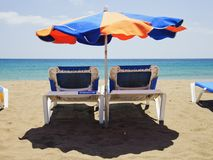 Beach umbrella and deckchairs Royalty Free Stock Image
