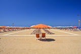 Beach umbrella and deckchairs Stock Image