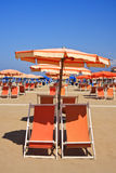 Beach umbrella and deckchairs Royalty Free Stock Images